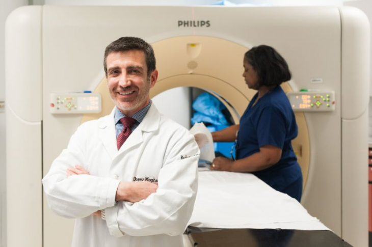 Dr. Drew Moghanaki is a lung cancer specialist who today serves as section chief of radiation oncology at the Atlanta VA Health Care System. In the background is Glenda Campbell, chief radiation therapist at Hunter Holmes McGuire VA Medical Center in Richmond, Virginia.