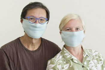 Man and woman wearing face masks