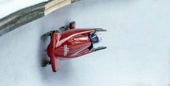 person in bobsled on ice track