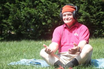 Marty Sigel, a 77-year-old Navy Veteran, tries out some meditation on a July day in Baltimore.