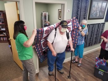 Vet Center welcomes home Vietnam Vets with quilts.