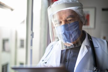 Health care workers sometimes wear face shields and masks.