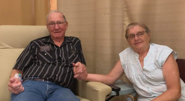 Elderly Veteran and spouse holding hands