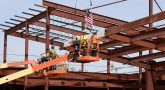 Construction workers placing a beam on new Terre Haute Clinic