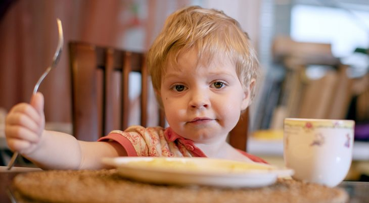 Little boy at a table of food