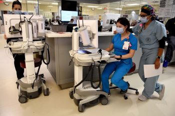 Two emergency nurses enter data on portable computer