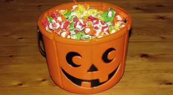 Carved pumpkin filled with candy