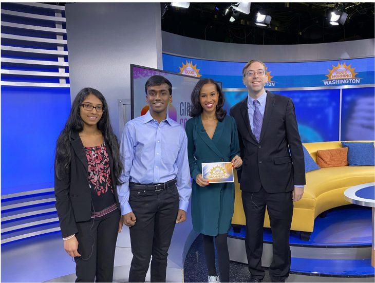 Members of the Girls Computing League and Dr. Gil Alterovitz discuss their participation in the 2019 AI Tech Sprint on Good Morning Washington. From left to right: Shreeja Kikkisetti, Neeyanth Kopparapu, Adrianna Hopkins, a reporter with ABC News 7, and Dr. Gil Alterovitz. (Photo was taken prior to COVID-19 pandemic.)