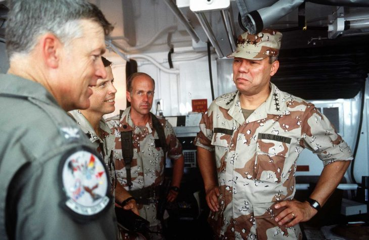 Army Gen. Colin Powell visits U.S. troops during the war.