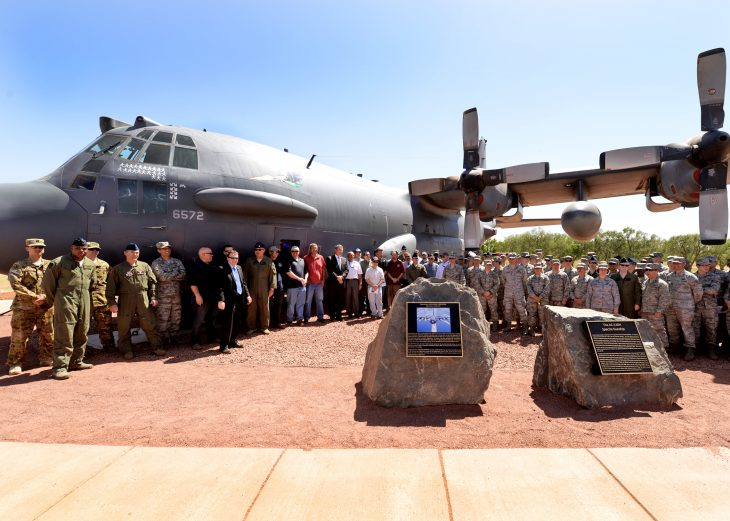 """Airmen and retirees young and old pose with """"Gravedigger,"""" a retired AC-130H Spectre gunship memorialized May 6, 2014, at Cannon Air Force Base, N.M. Gravedigger was the aircraft on the Ghost 02 Desert Storm mission. (U.S. Air Force Photo/Airman 1st Class Chip Slack)"""