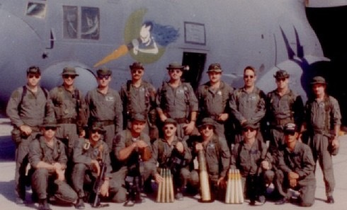 AC-130H crew members stand in front of an aircraft during Desert Shield.
