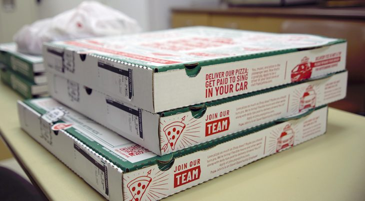Several large boxes of pizza