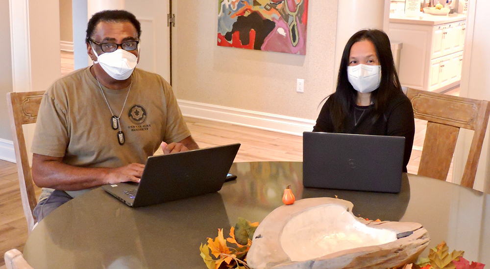 Analisa and Daryl Pinkney, guests at VA Fisher House, utilize an Intel donated laptop to gain access to VA Connected Care and My HealtheVet.