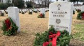 A wreath lies at the grave of Army Sgt. 1st Class William M. Bryant during the 2019 Wreaths Across America event at Raleigh National Cemetery, North Carolina. VA photo by Adam Stump.