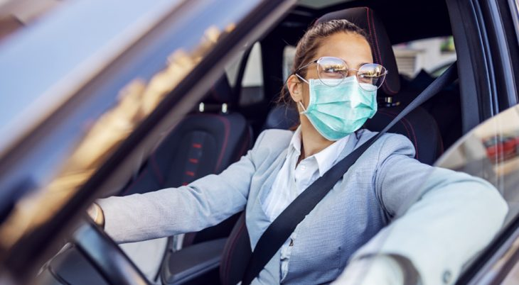 Woman in car ready for flu shot.