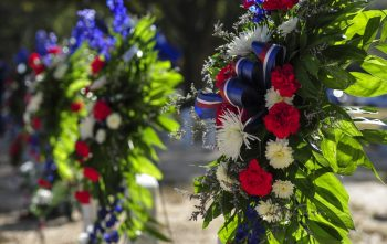 Photo of Wreaths on display at two gravesites in Barrancas National Cemetery.