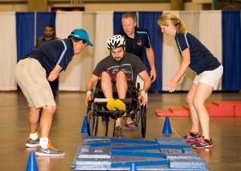veteran in wheelchair going over obstacle course