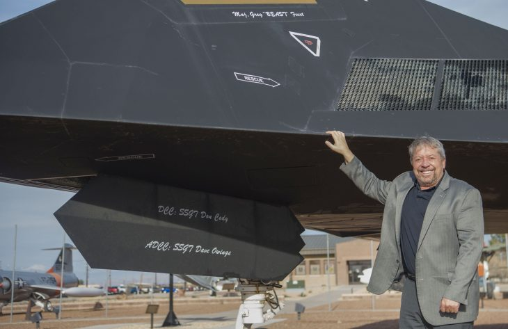 Feest poses for a photo in front of the F-117 Nighthawk dedicated to him on Holloman Air Force Base, N.M, Dec. 11, 2019.