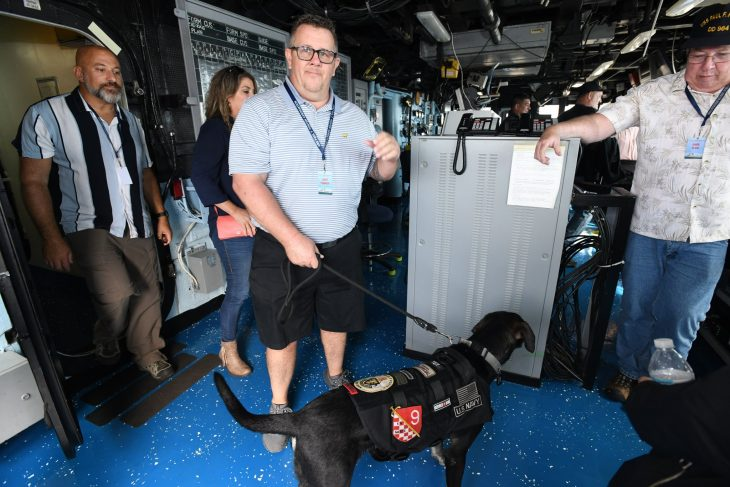 Frawner and his service dog, Tex, aboard USS Paul F. Foster in September 2019. Frawner's then-fiancee Lyndi is in the background.