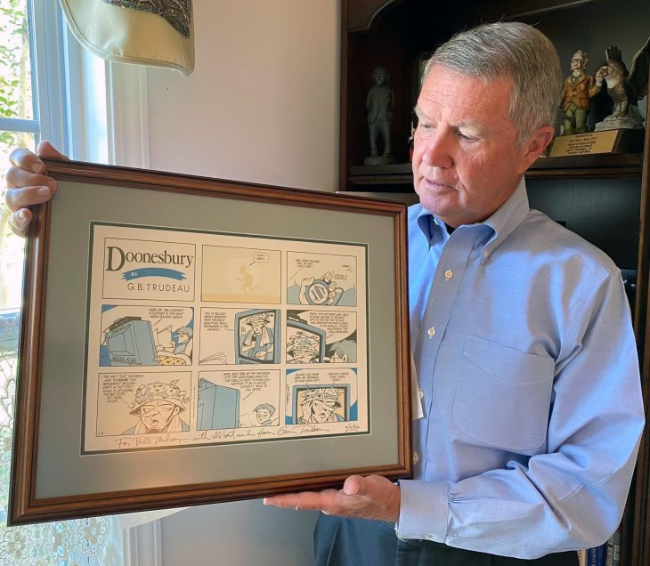 Army Veteran Bill Mulvey holds a comic from Doonesbury creator Garry Trudeau.