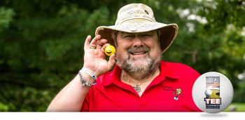 Veteran holding a golfball at the National Disabled Veterans TEE Tournament