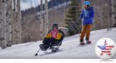Veteran using a sit-ski at the National Disabled Veterans Winter Sports Clinic